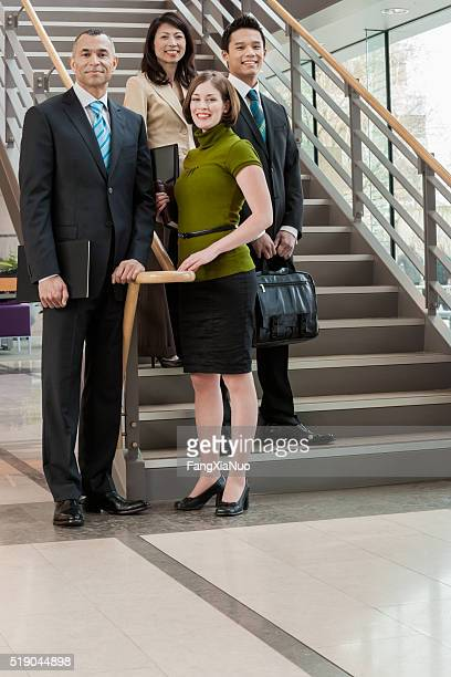 Businesspeople standing on a stairway