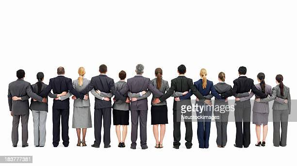 businesspeople standing with backs to the camera - isolated - arm around stock pictures, royalty-free photos & images