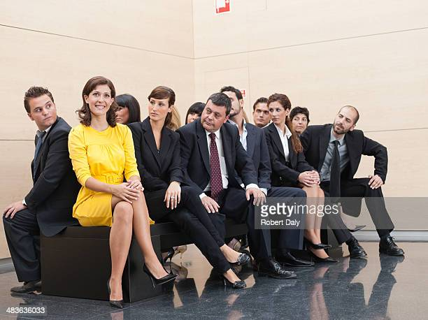 businesspeople staring at unique co-worker - individuality stock photos and pictures
