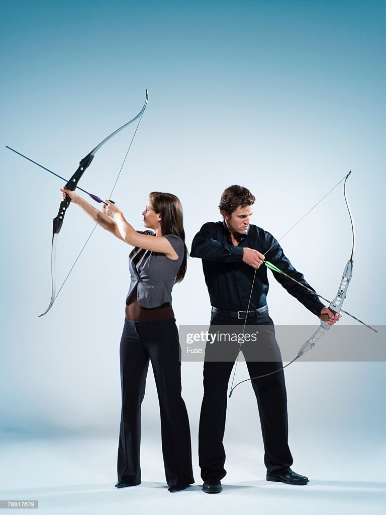 Businesspeople Taking Aim : Stock Photo