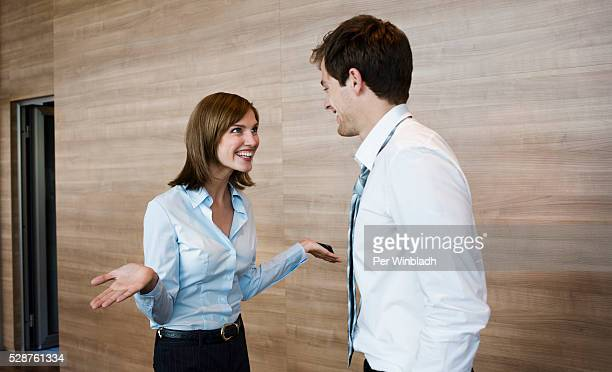 Businesspeople talking and smiling