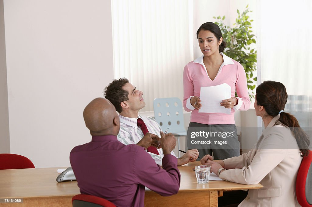 Businesspeople talking in office meeting : Stockfoto