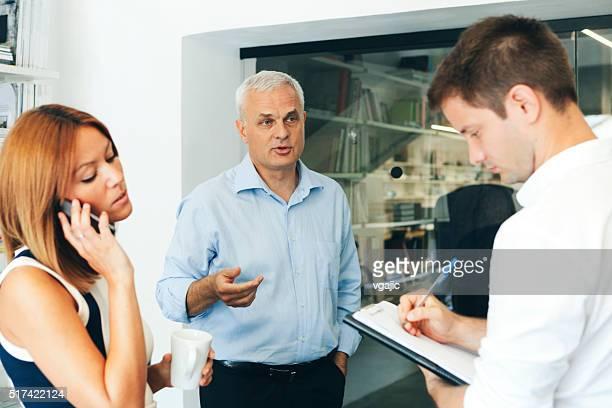Businesspeople talking in office.