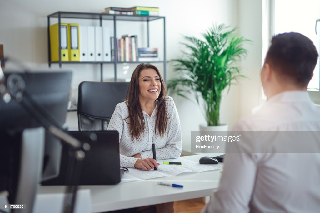 Businesspeople talking in the office : Stock Photo