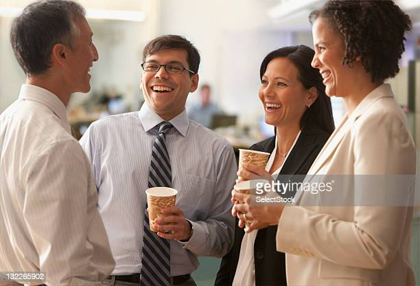 businesspeople talking over coffee break - coffee break stock pictures, royalty-free photos & images