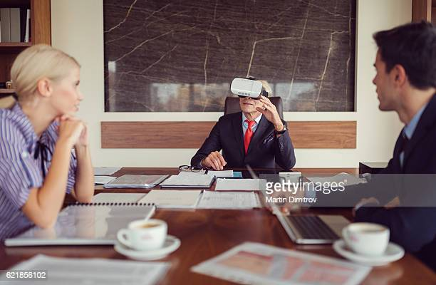 Businesspeople trying virtual reality simulator