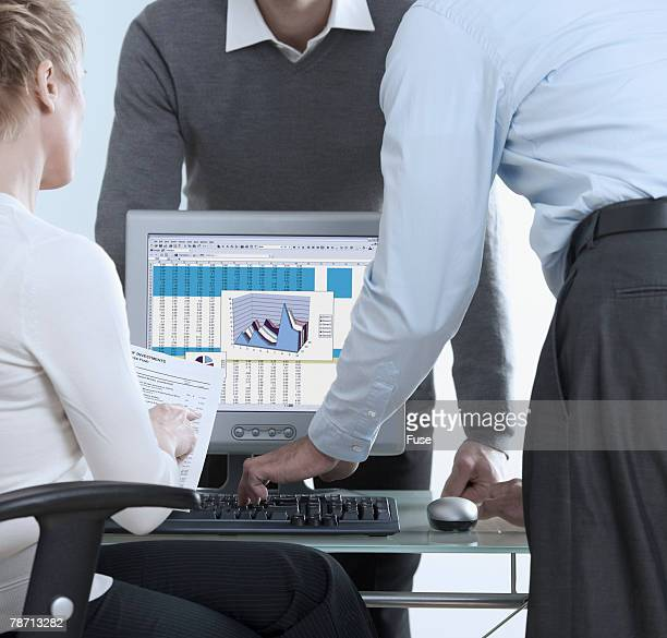 businesspeople using computer during meeting - computer system diagram stock photos and pictures