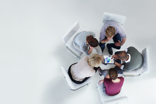 Businesspeople using digital tablet together - gettyimageskorea