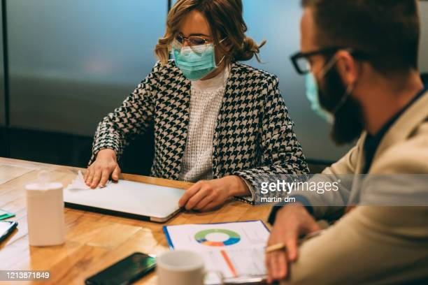 businesspeople using disinfection wipes during covid-19 - single use stock pictures, royalty-free photos & images