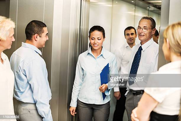Businesspeople waiting for an elevator