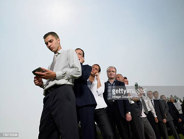 Businesspeople waiting in a queue