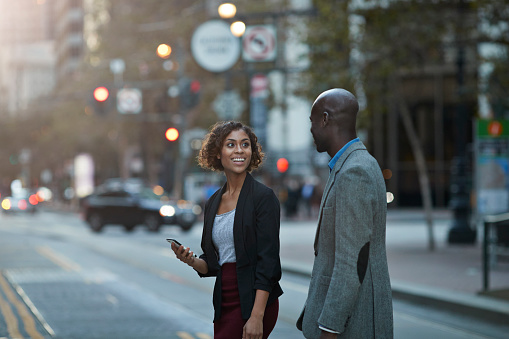 Businesspeople walking and talking on avenue of San Francisco - gettyimageskorea
