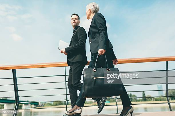 Businesspeople Walking and Talking outdoors.