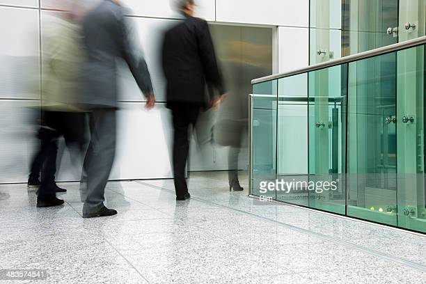 Businesspeople walking in a modern interior