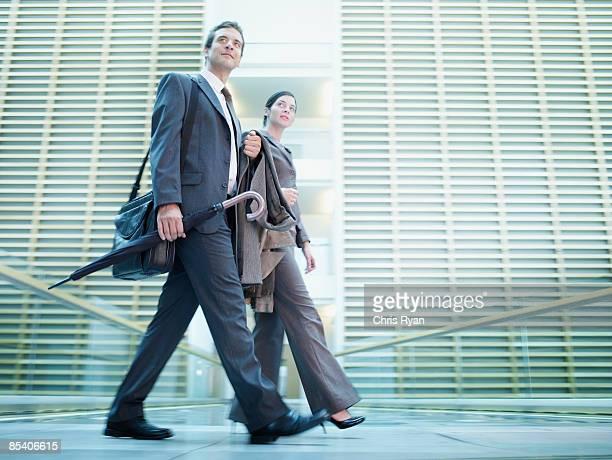 Businesspeople walking in building atrium