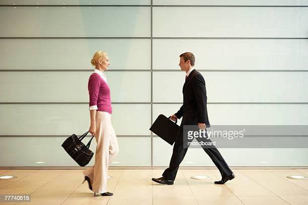 Businesspeople Walking in Office Hallway