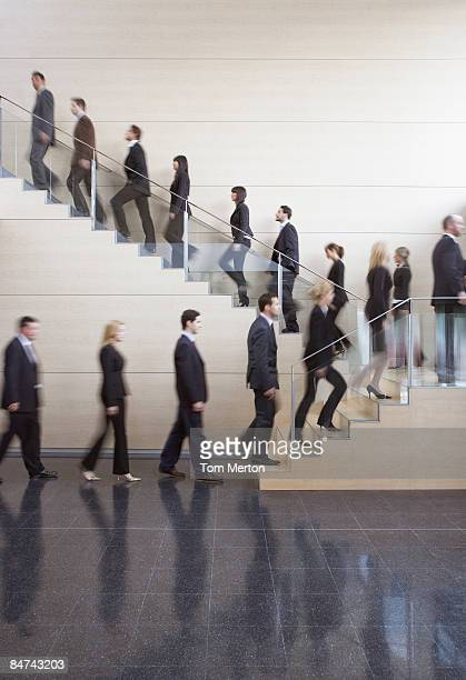 Businesspeople walking on office staircase