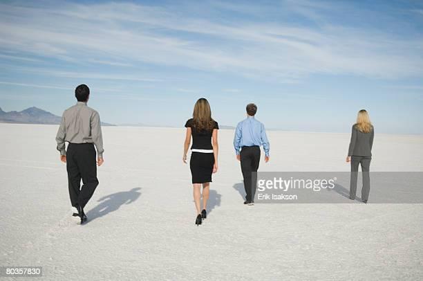 Businesspeople walking on salt flats, Salt Flats, Utah, United States