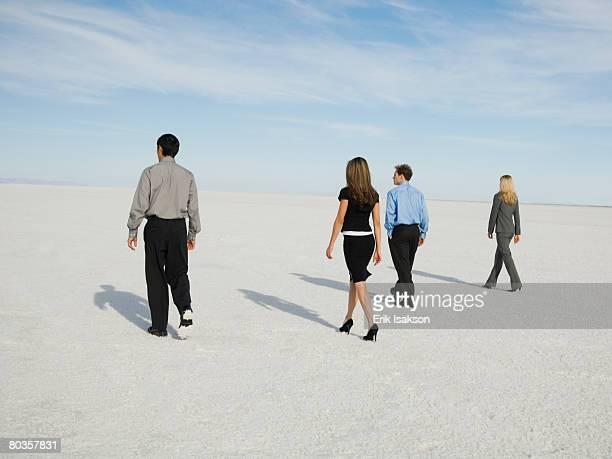 businesspeople walking on salt flats, salt flats, utah, united states - schrägansicht stock-fotos und bilder