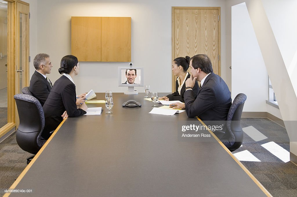 Businesspeople watching video conference in a conference room : Stockfoto