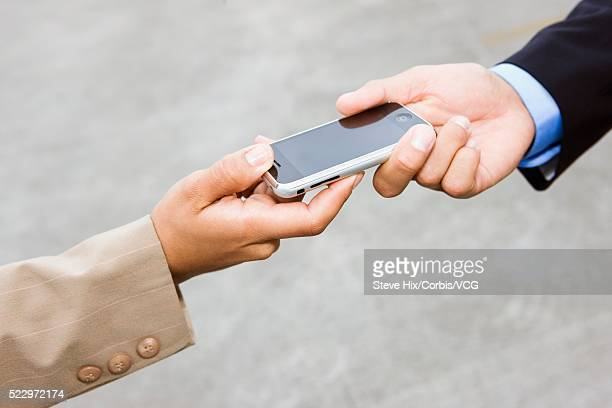 Businesspeople with a cell phone