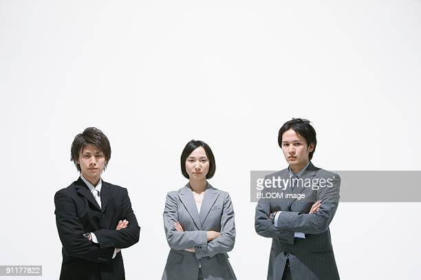 Businesspeople with arms crossed