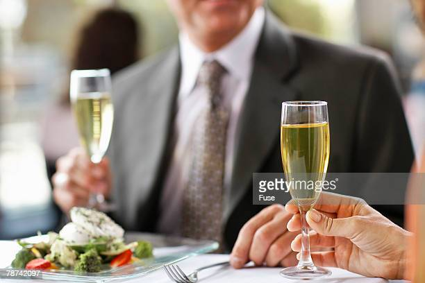 Businesspeople with Champagne Glasses