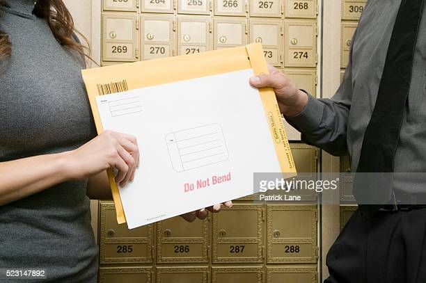 businesspeople with envelopes - patrick grant stock pictures, royalty-free photos & images