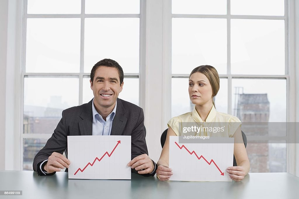 Businesspeople with graphs : Stock Photo