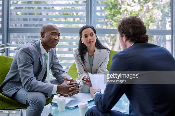 Businesspeople with partner explaining strategy