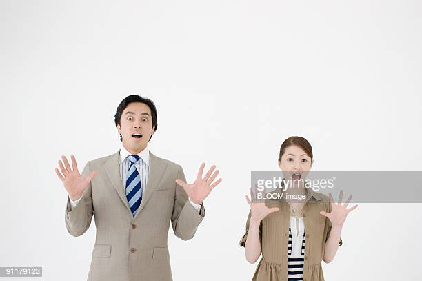 Businesspeople with surprised expression
