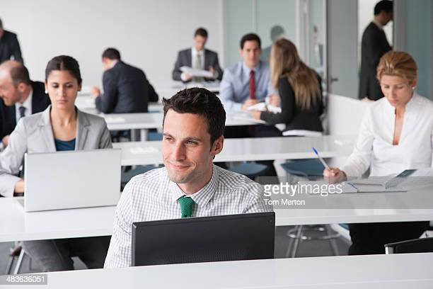 Businesspeople working in corporate training facility
