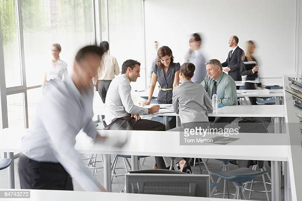 businesspeople working in corporate training facility - overhemd en stropdas stockfoto's en -beelden
