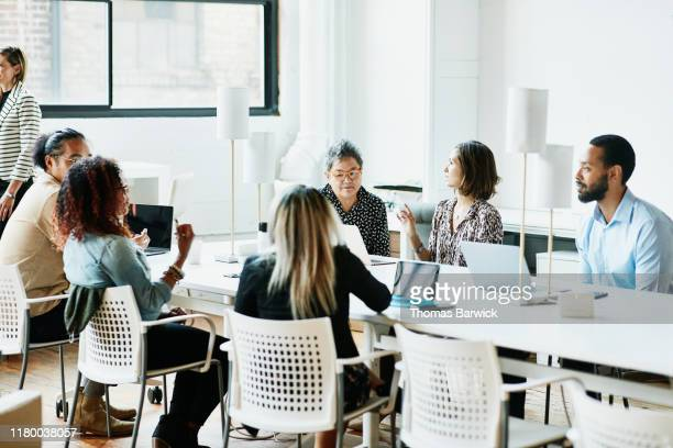 businesspeople working in coworking office - diversity stock pictures, royalty-free photos & images
