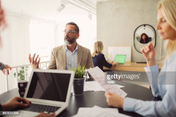 businesspeople working in the modern office - incidental people stock pictures, royalty-free photos & images