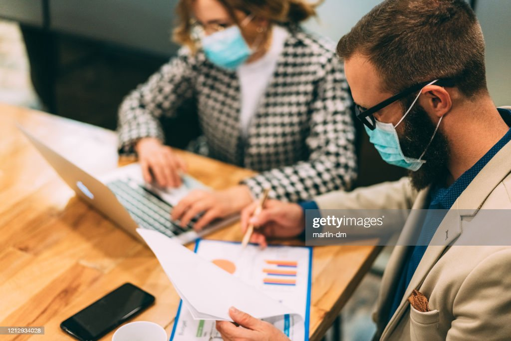 Businesspeople working late at night : Stock Photo
