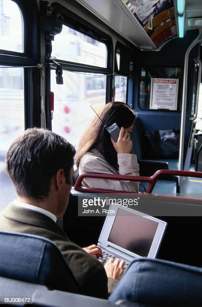 Businesspeople Working on Bus