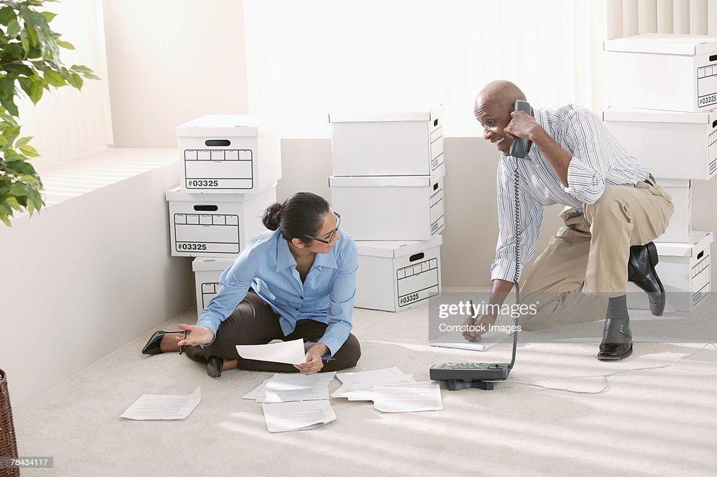 Businesspeople working on floor of office : Stockfoto
