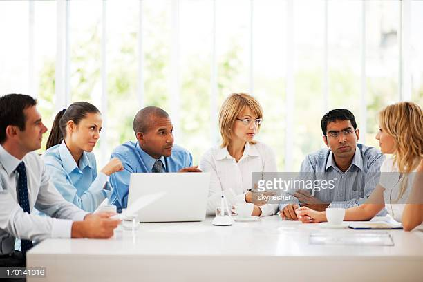 Businesspeople working on laptop in an office.