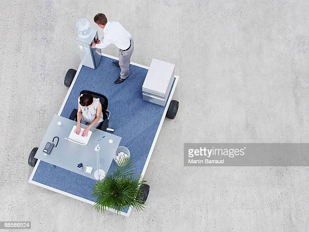Businesspeople working on portable office