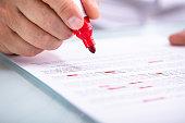 Businessperson Holding Marker On Document