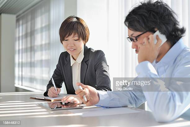 Businessperson with a meeting using a digital tabl