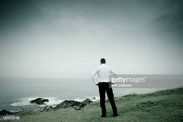 businesssman on a clifftop