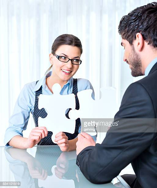 Businessteam are stitching puzzle