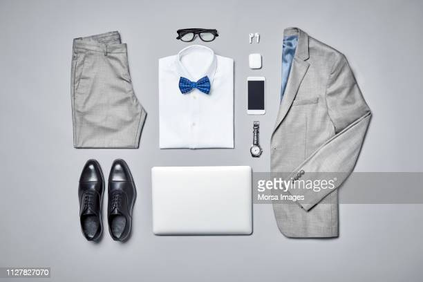 businesswear arranged on gray background - bow tie stock pictures, royalty-free photos & images