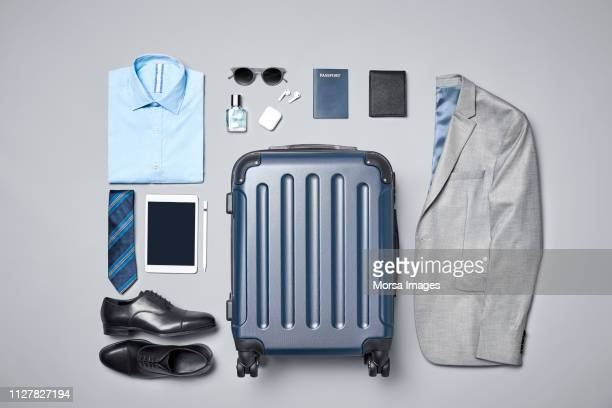 businesswear with luggage and travel accessories - bolsa objeto fabricado fotografías e imágenes de stock