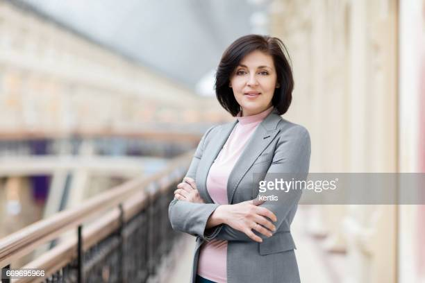 Businesswoman 50 years old in a gray jacket