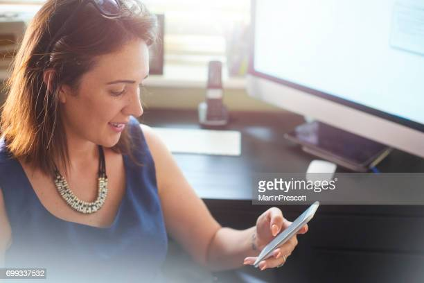 Businesswoman about to ring a client