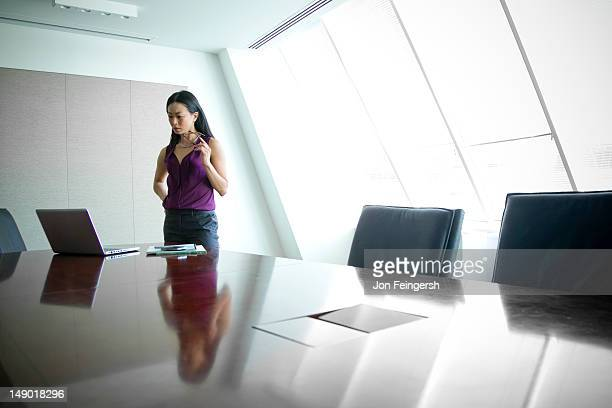 Businesswoman alone at board table