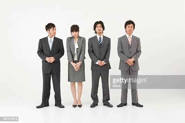 Businesswoman among three businessmen